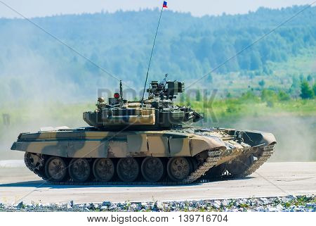 Nizhniy Tagil, Russia - July 12. 2008: Shooting tank T-80s moving through cross-country terrain with obstacles. Display of fighting opportunities of arms and military equipment. RAE exhibition