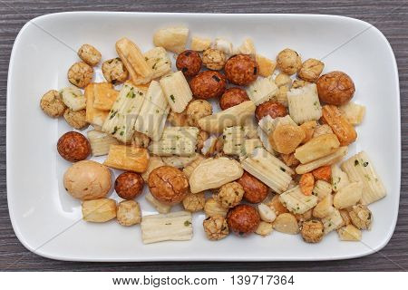 Japanese rice crackers on white ceramic plate