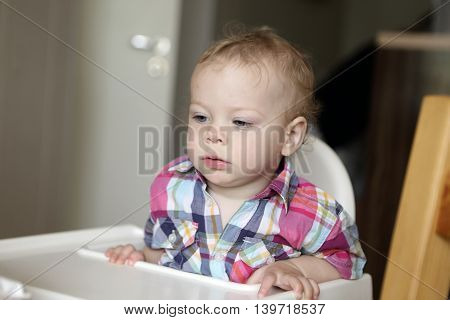 Child At High Chair