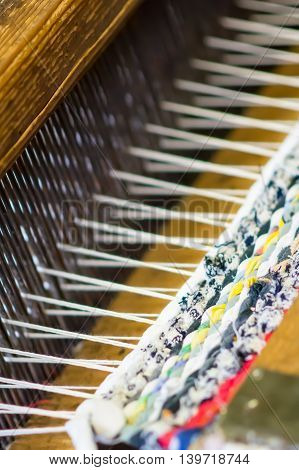 Detail of traditional weaving loom and thread