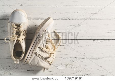 Vintage shoes on wood board Top view of sneakers shoes