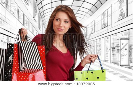 Beautiful shopping woman at a drawn mall