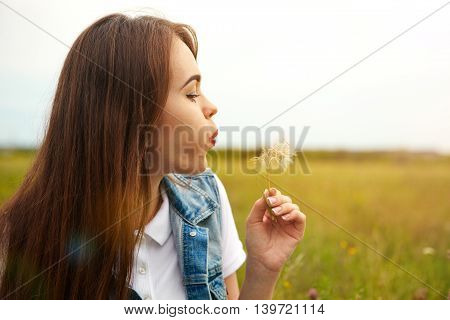 Beautiful Girl In A Meadow In The Morning