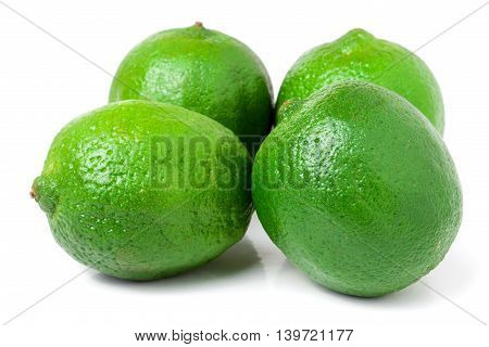 four lime isolated on white background close up.