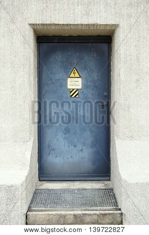 Blue metal door in a concrete wall