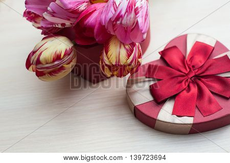 tulips and red box for gift in form of heart.