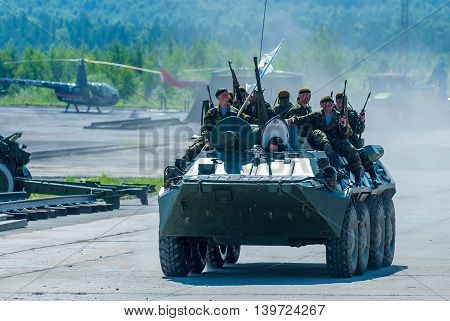 Nizhniy Tagil, Russia - July 12. 2008: Group of special forces unload from BTR-82A armoured personnel carrier on shooting demonstration range