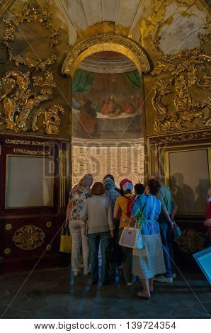 VELIKY NOVGOROD RUSSIA-JULY 15 2016. Tourists at the excursion in the interior of St Nicholas Cathedral at Yaroslav courtyard. Soft filter applied