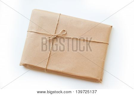 envelope kraft paper tied with string on a white background.