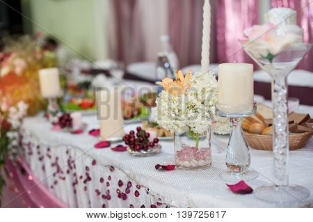 decorations with candles on a wedding table in a restaurant.