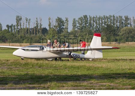Bialystok Poland July 24 2016: Pilots after landing tow glider hangar