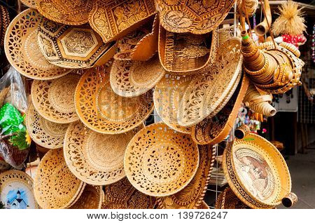 VELIKY NOVGOROD RUSSIA-JULY 22 2016. Plates made of birch bark with various forms and patterns - traditional Russian handmade tableware. Souvenir trade.