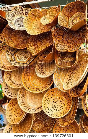 VELIKY NOVGOROD RUSSIA-JULY 22 2016. Plates made of birch bark with various forms and patterns - traditional Russian Slavic handmade tableware. Souvenir trade.