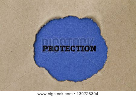 protection word written under torn paper concept.