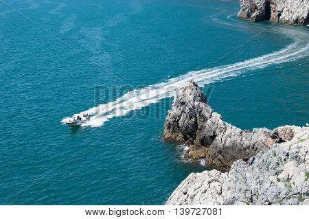 motor boat in the sea, photo from a height