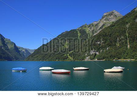 Summer scene at lake Klontal. Mt Mutteristock.
