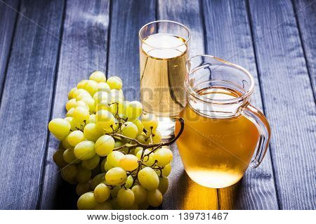 Grape juice in the glass and pitcher still life