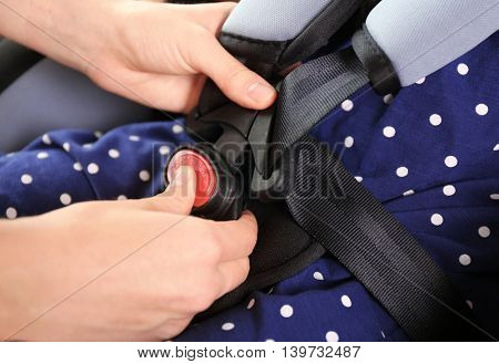 Child in baby car seat, closeup