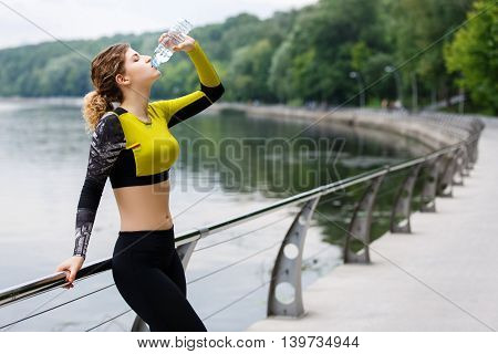 Portrait of young blonde woman with excellent sporty body
