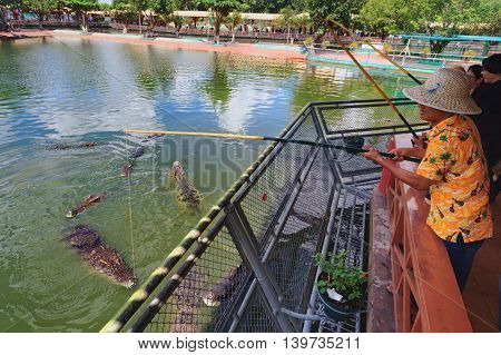 Ho Chi Minh city ( Saigon ) Vietnam - September 02 2015: People have fun - feed crocodiles in historical theme adventure park and children water park Suoi Tien - Vietnam popular travel destination.