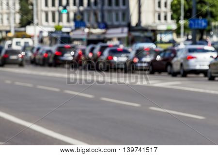 City traffic, blurred unfocused image. Day road with cars. Copy space for text