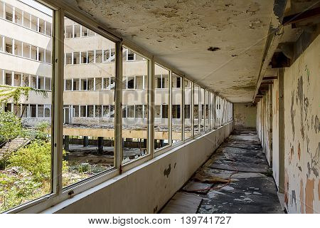 KUPARI, CROATIA - AUGUST 2015: Inside Hotel Peregrin. still abandoned 25 years after the end of the Croatian War of Independence