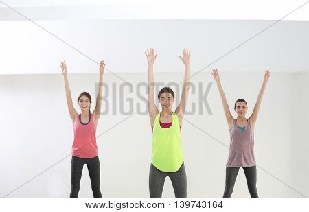 Young women doing exercise in gym