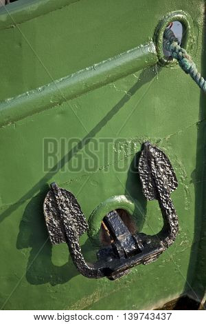 black anchor on green a old ship