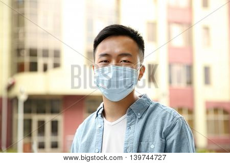 Ill man wearing mask on the street