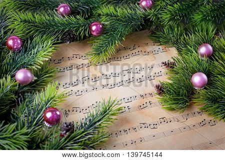 Christmas decorations on music sheets, close up