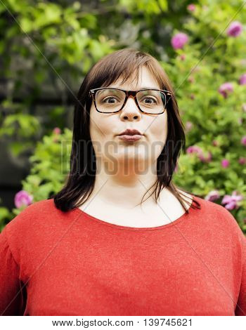pretty modern mature fat woman outside wearing glasses, lifestyle people concept