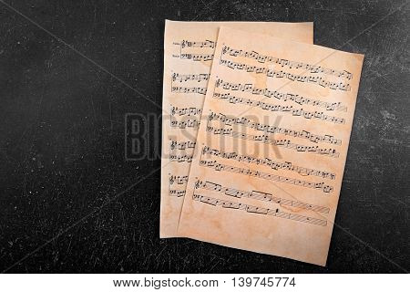 Music notes sheets on grey background