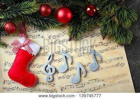 Christmas decorations on music sheets