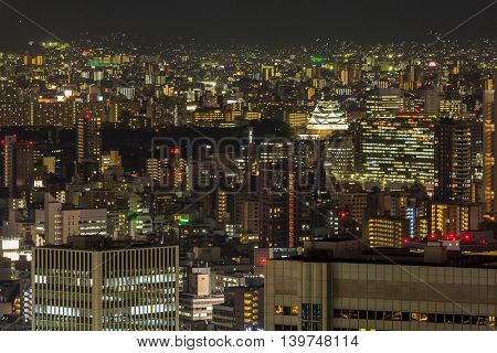Osaka castle with Skylines building at night Japan