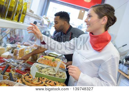 happy sellers working in catering