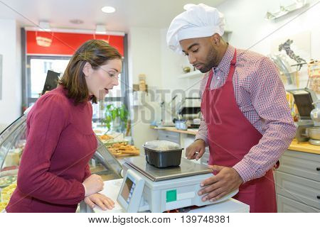 confectioner selling food in the catering shop