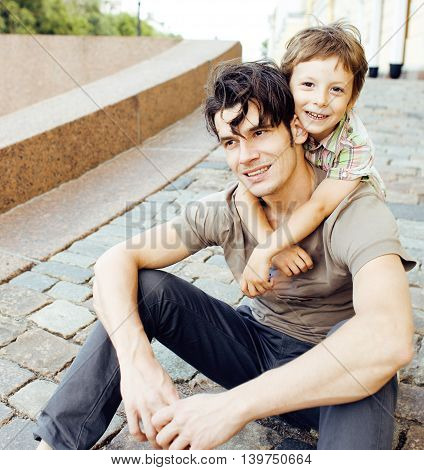 little son with father in city happy hugging close up smiling, lifestyle people at vacations concept