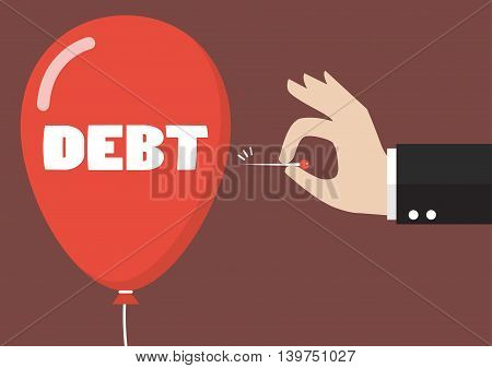 Hand pushing needle to pop the debt balloon. Business concept