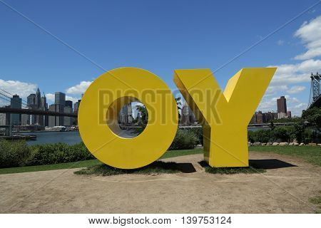 BROOKLYN, NEW YORK - JULY 19, 2016: Monumental sculpture OY/YO by acclaimed artist Deborah Kass in Brooklyn Bridge Park