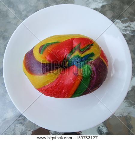 Unique multicolored rainbow bagel served for breakfast