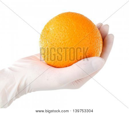 Allergy concept. Hand in glove holding orange isolated on white