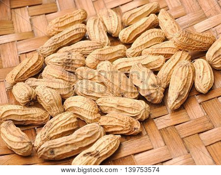 Peanut or groundnut on the bamboo cage