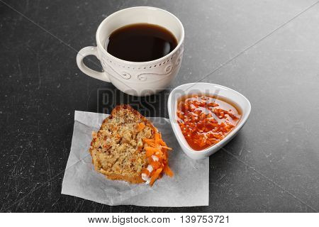 Delicious slice carrot cake with coffee on table