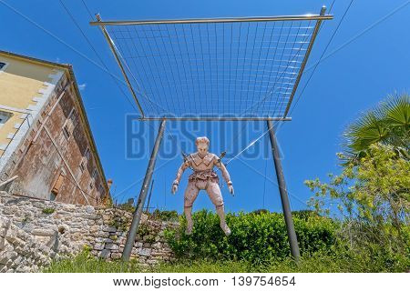 PRVIC LUKA, CROATIA - June 5, 2016 The statue of first paratrooper at the entrance to the museum of Croatian Renaissance inventor Faust Vrancic, today known as Homo Volans the flying man.