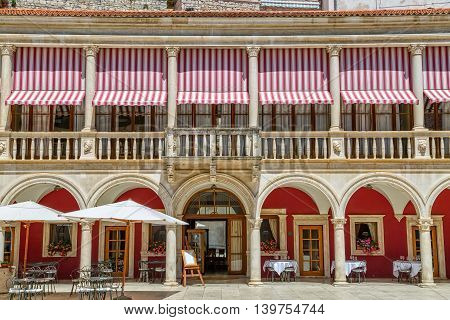 SIBENIK, CROATIA - June 4, 2016: Old restaurant with white table clothes on the Republic square in city center.