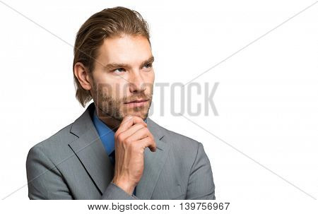 Handsome businessman in a pensive expression