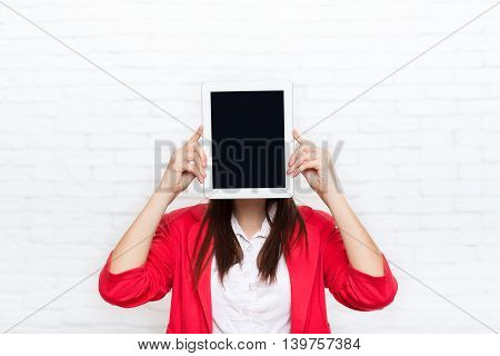 Businesswoman show tablet computer screen with empty copy space wear red jacket glasses happy smile business woman over office wall