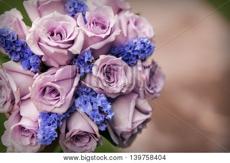 Bride's bouquet in purple colors horizontal composition