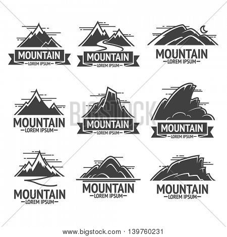 Set of mountain exploration vintage logos, emblems or silhouettes . Logotype templates and badges with mountains. Vector Illustration.