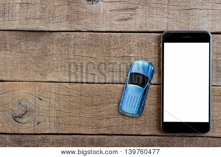 phone and car model toy on wood table top view